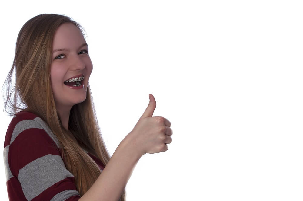 Young girl giving a thumbs up